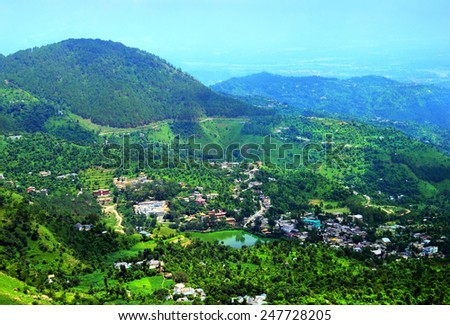 Beautiful aerial view - serene lake Tsopema in Rewalsar (Revalsar, Trisangam) - sacred city for three major Dharma religions - Hinduism, Buddhism and Sikhism, Mandi district, Himachal Pradesh, India - stock photo
