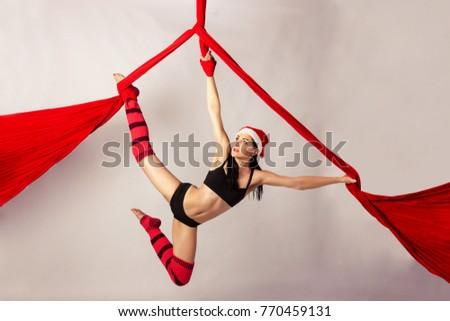 beautiful aerialist girl doing acrobatic and flexible tricks on red aerial silks  tissues  on elegant female dance posing on aerial stock photo 290950214      rh   shutterstock