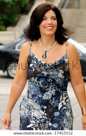 Beautiful Affluent Woman Shopping In The City - stock photo