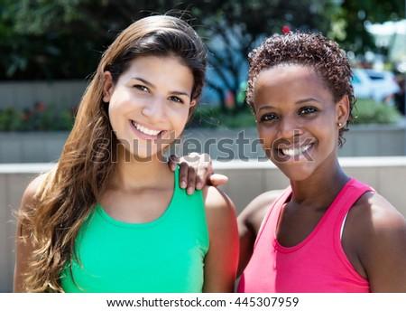 Beautiful african american and caucasian woman - stock photo