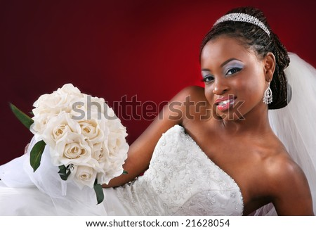 Beautiful African American Bridal Portrait on Red Dark Background - stock photo