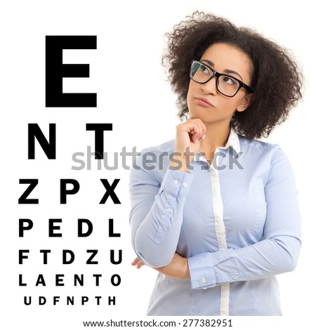 beautiful african american business woman in glasses and eye test chart isolated on white background - stock photo