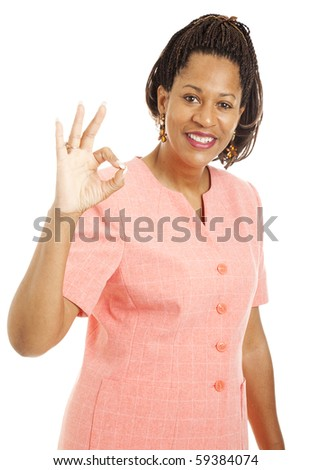 Beautiful african-american businesswoman giving the okay sign.  Isolated on white. - stock photo