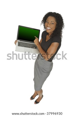 Beautiful African American businesswoman holding and pointing at a laptop computer with clipping path