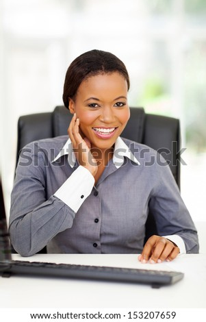 beautiful african american businesswoman sitting in office