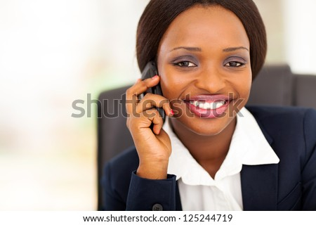 beautiful african american businesswoman talking on mobile phone - stock photo