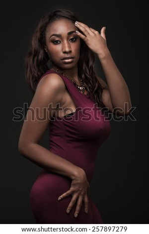 Beautiful African-American fashion model with long curly hair. - stock photo