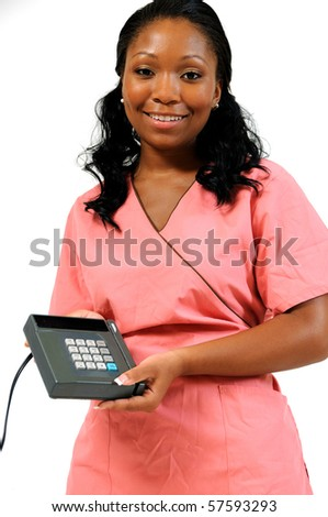 Beautiful African American female medical professional holding credit card processing machine wearing scrubs