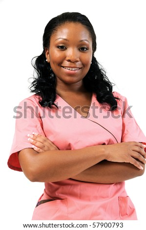 Beautiful African American female medical professional in scrubs - smiling arms folded