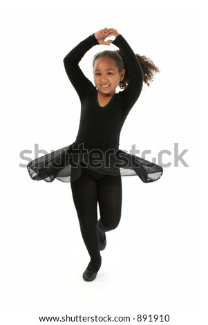 Beautiful African American girl ballerina spinning. - stock photo