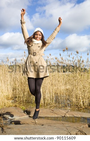 Beautiful african american girl jumping in air - stock photo