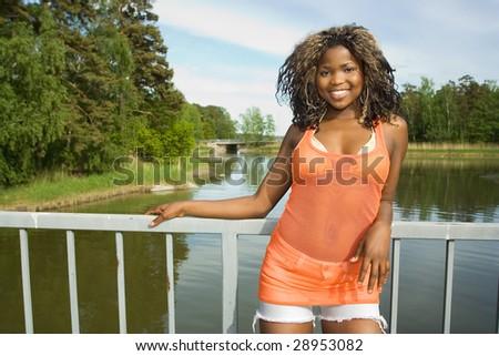 Beautiful african american girl on a bridge - stock photo