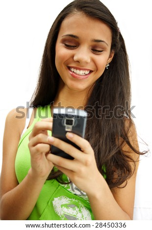 Beautiful african american girl smiling with her cellphone. - stock photo