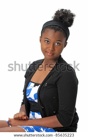 Beautiful African American Haitian teen girl wearing a dress, sweater and with her hair up.  Photographed on a white background. Space for copy. - stock photo