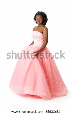 Beautiful African American Haitian teen girl wearing a pink strapless princess prom dress. Posing and smiling on a white background. Space for copy. - stock photo