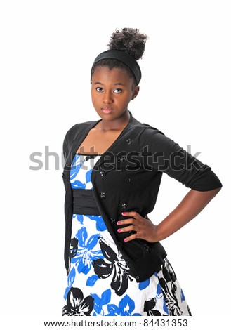 Beautiful African American Haitian teenaged girl wearing a dress and sweater with her hair up.  Posing with attitude on a white background.  Space for copy. - stock photo