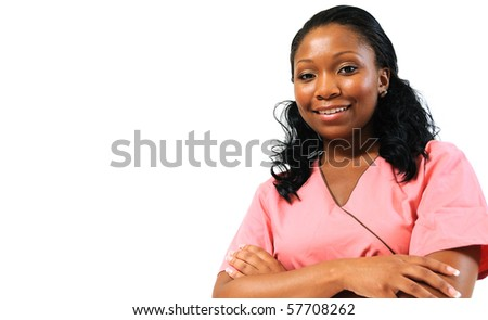 Beautiful African American healthcare professional in pink scrubs - smiling - stock photo