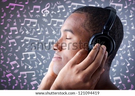 Beautiful African American man listening to music on musical notes background - stock photo