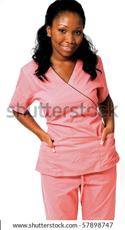 Beautiful African-American medical professional in pink scrubs smiling with hands in pockets - stock photo
