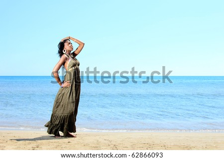 Beautiful African-American model by the sea - stock photo