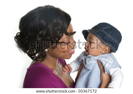 Beautiful African-American mother smiling at her baby boy - stock photo