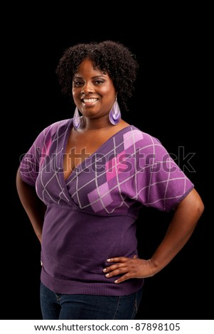 Beautiful African American Plus Size Female Fashion Model Headshot Portrait on Black background - stock photo