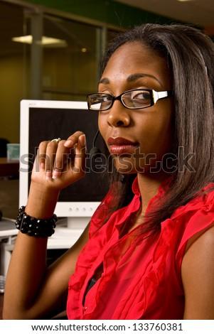 Beautiful African American receptionist - stock photo