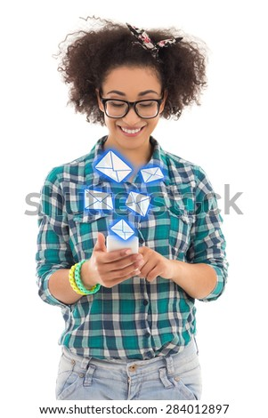 beautiful african american teenage girl sending sms messages with mobile phone isolated on white background