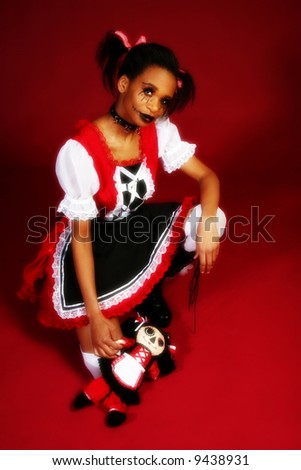 Beautiful African American woman dressed as Anime Goth Doll. - stock photo