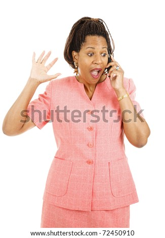 Beautiful african american woman gets exciting news over her mobile phone.  Isolated on white. - stock photo
