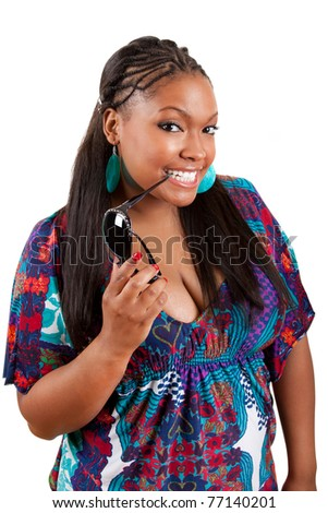 beautiful african american woman holding sunglasses over a white background - stock photo