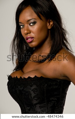 Beautiful african american woman in a corset - stock photo