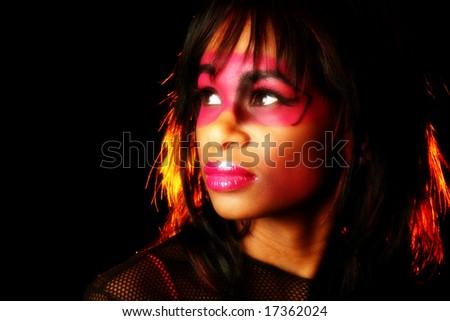 Beautiful African American woman in artistic cosmetics. - stock photo