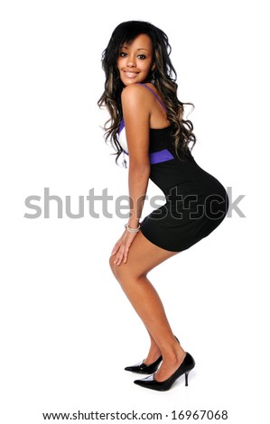 Beautiful African American woman in black dress and high heels
