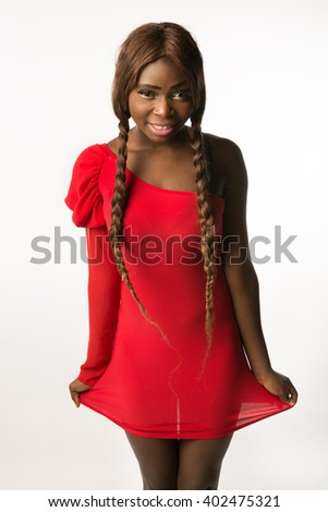 Beautiful african-american woman in red sexy slinky dress smiling. Isolated
