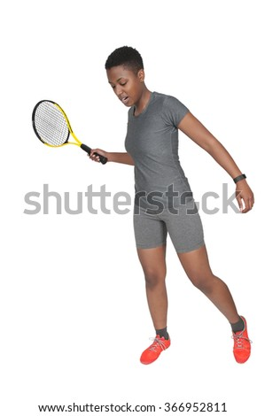 Beautiful African American woman playing the sports game of tennis