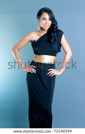 Beautiful African American Woman posing with hands on waist - stock photo