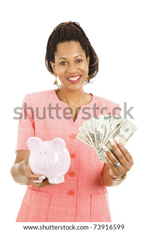 Beautiful african-american woman saving money in her piggy bank.  Isolated on white.