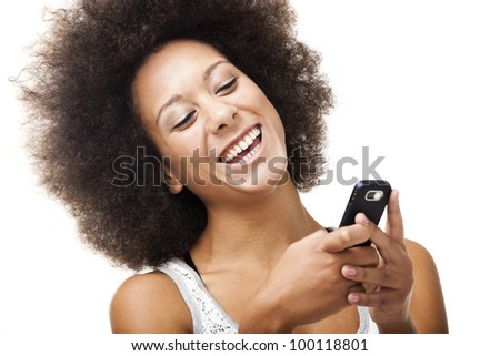Beautiful African American woman sending a sms on cell phone, isolated on white background - stock photo