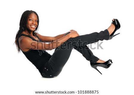 Beautiful African American woman sitting isolated over white background - stock photo
