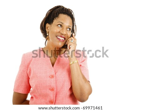 Beautiful african-american woman talking on her cellphone.  Isolated on white.