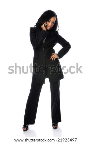 Beautiful African American woman using cell phone standing over a white background