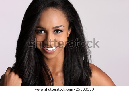beautiful African-american woman with a broad smile and pretty black hair. - stock photo