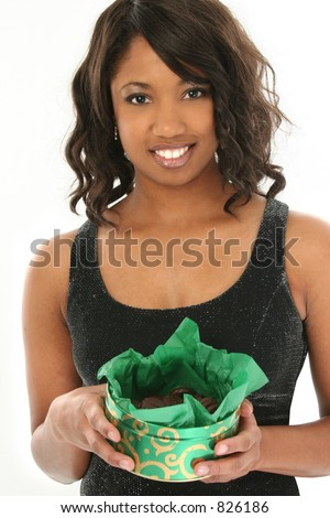 Beautiful African American Woman with Box of Chocolate Mint Candies.  In formal party dress.  Great smile.