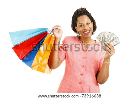 Beautiful african-american woman with cash to spend on a shopping spree.  Isolated on white - stock photo