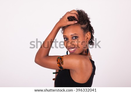 Beautiful African American woman with curly hairs isolated on white background