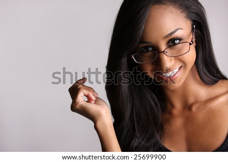 beautiful african-american woman with glasses smiling.