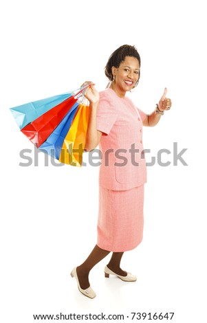 Beautiful African-american woman with shopping bags, giving the thumbs-up sign.  Full body isolated on white.