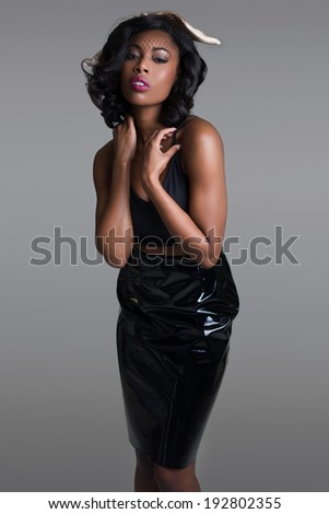 Beautiful African American young woman posing in the studio - stock photo