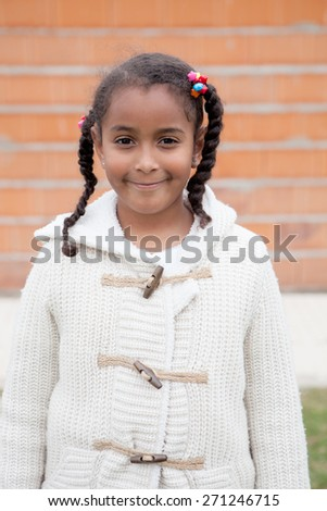 Beautiful african child with a brick wall of background - stock photo